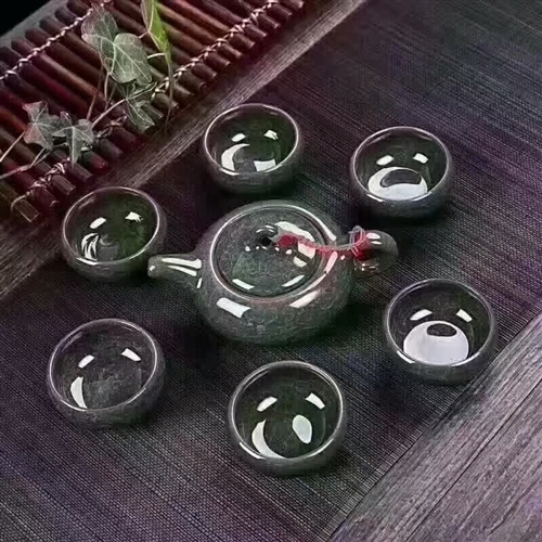 冰裂茶具7件套  冰裂茶具 冰裂轴是指在多层次的立体结构裂纹,造成犹如花瓣般的层面。杯壁厚实,口缘宽...