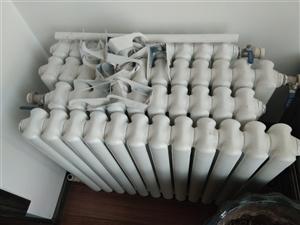 钢制暖气片,12柱2组,10柱2组,共4组,九成新。