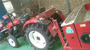 出售,洛拖400一台,带一个小麦播种机,拖拉机9成