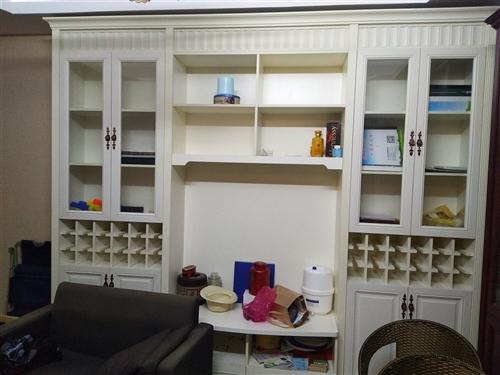 本专卖店搬迁,现店里所有多层实木生态板样板柜(有酒柜,衣柜,书柜带1米2折叠床,电视背景墙酒柜,橱柜...