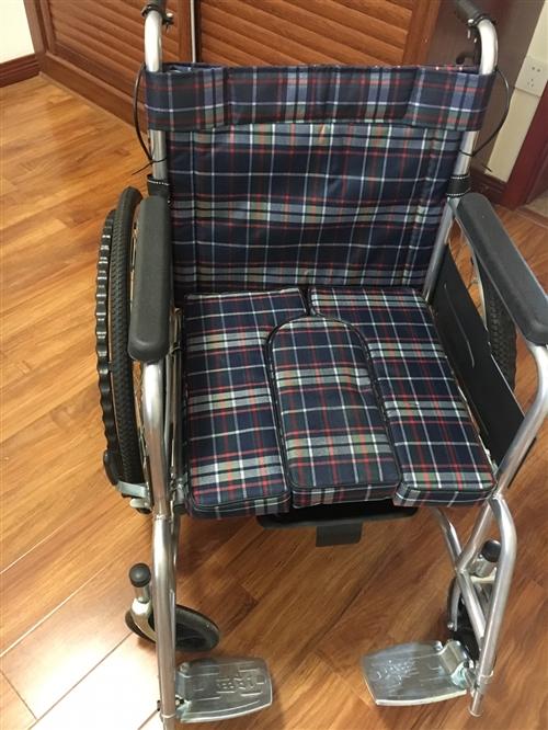 一次未用的手推輪椅