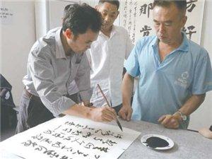 枣庄一残疾人自创培训基地;免费教残疾人书画;还管学员午饭