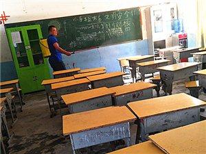 从江:预防和控制传染病,光辉小学对校园进行全面消毒