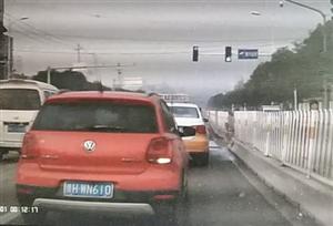女司机路口实线违法变道,险酿事故