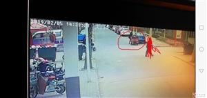 肇事红色三轮车及驾驶员