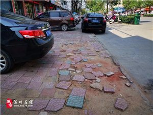 潢川城�^的路是修不完了都,主路修完,人行道旁�的路又�@�恿�