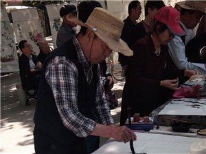 【今日头条】庆祝5.23讲话书画展在县财苑广场举行