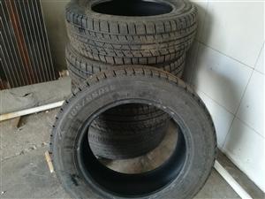 出售4根防滑轮胎。89成新,规格185.65.15.
