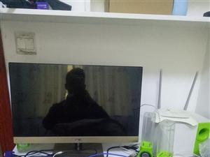 显示器可以当电视用,有独立的遥控器。主机自己组装的,急用钱,时间就限今晚和明天。要的速速过来看电脑。