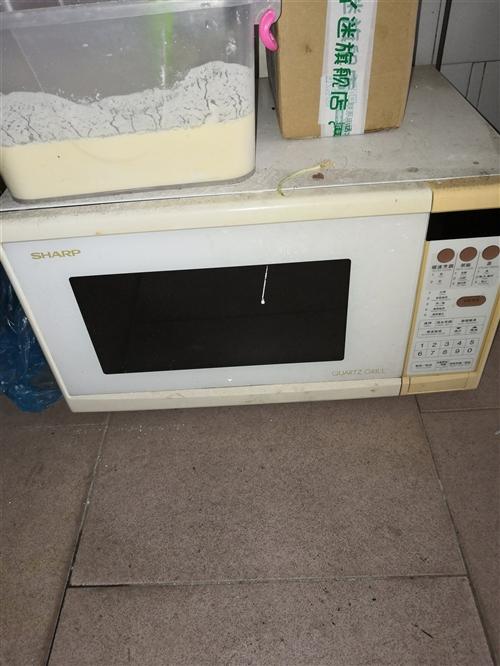 进口夏普微波炉带烤箱150元转让,一切功能正常,东西非常好