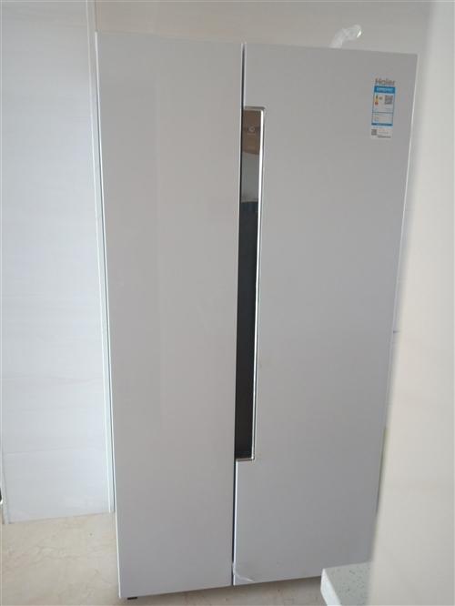 全新海爾風冷無霜冰箱出售,因為買大了所以出售有意者電話聯系13314758198