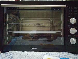 全新美的烤箱一次都�]用�^,��I的�r候�]看好大小,太大�N房放不下,�f明��找不到了,30多升容量……