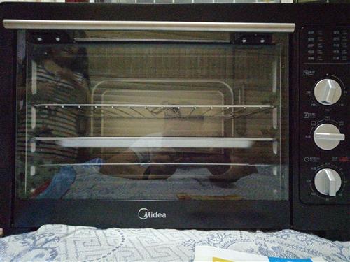 全新美的烤箱一次都没用过,购买的时候没看好大小,太大厨房放不下,说明书找不到了,30多升容量……