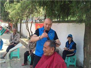 太平镇高笠村免费为老人孩子理发、义诊、慰问贫困户
