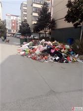 新县二中洞口红高粱小区垃圾成山无人管?