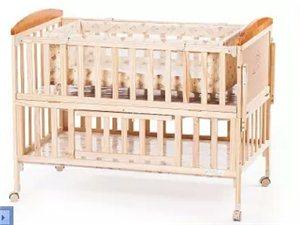 婴儿床,小龙哈皮的牌子,9成新,送床围,根本就没怎样用过的小床