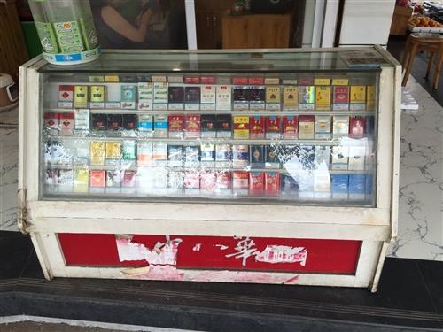 店面拆迁,转让两个烟柜,4个实木水果架!需要的联系!