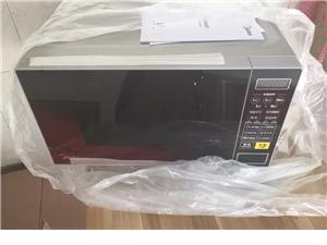 家用美的微波炉全新的一次未用过。型号L213C,需要加电话微信