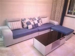 沙发和茶几都是8成新,现在处理中,沙发长3米,布衣沙发;  茶几是120*60