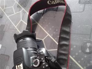 出售佳能650D带18--55镜头单反相机一台,九成新。原装二电一充,正规行货发票,带包,遥控器,数...