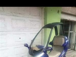 带蓬的摩托车,蓬可以折叠,带播放器的,夏天下雨浇不着,油耗每公里0.15元,摩托车的油耗轿跑的感觉。...