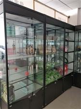 钛合金美容用品展示架,带射灯和玻璃门,单个1.2米宽,高2.2米共9个,原做成9000元,五六成新,...